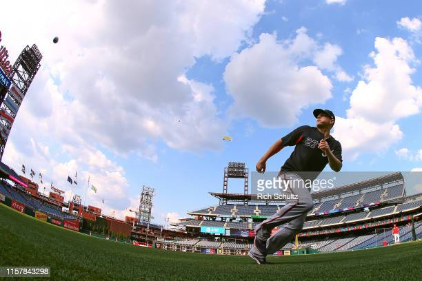 Austin Riley of the Atlanta Braves chases down a ball during a pregame drill before a game against the Philadelphia Phillies at Citizens Bank Park on...