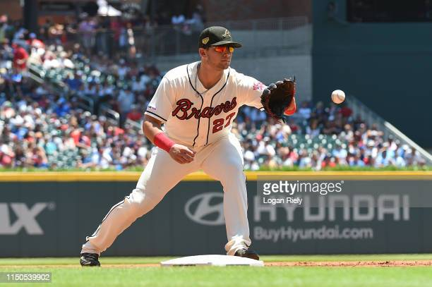 Austin Riley of the Atlanta Braves fields a ball against the Milwaukee Brewers at SunTrust Park on May 19, 2019 in Atlanta, Georgia.