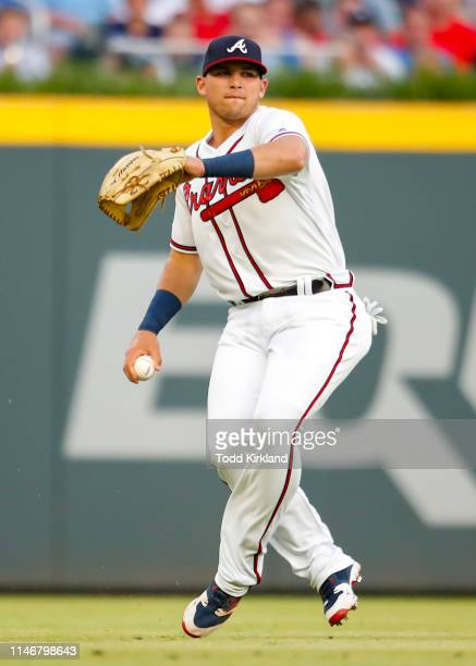 Austin Riley of the Atlanta Braves fields a ball and throws back to the infield in the fourth inning of an MLB game against the Washington Nationals...