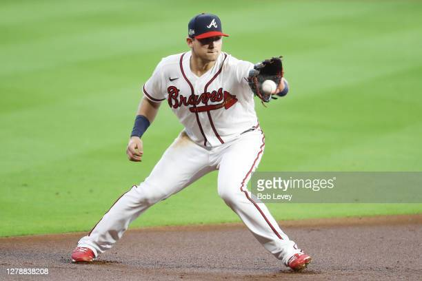 Austin Riley of the Atlanta Braves fields a ball hit by Chad Wallach of the Miami Marlins for the final out of the second inning in Game One of the...