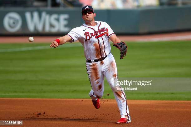 Austin Riley of the Atlanta Braves fields and throws to first in the first inning of game one of an MLB doubleheader against the Washington Nationals...