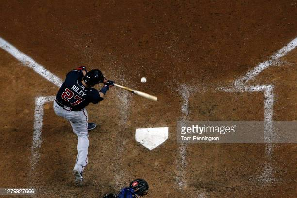 Austin Riley of the Atlanta Braves hits a solo home run against the Los Angeles Dodgers during the ninth inning in Game One of the National League...