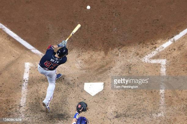 Austin Riley of the Atlanta Braves hits an RBI single against the Los Angeles Dodgers during the fourth inning in Game Seven of the National League...