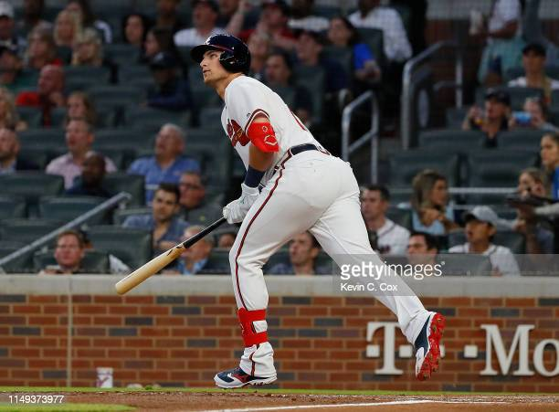 Austin Riley of the Atlanta Braves hits his first Major League home run in the fourth inning during his MLB debut against the St. Louis Cardinals at...