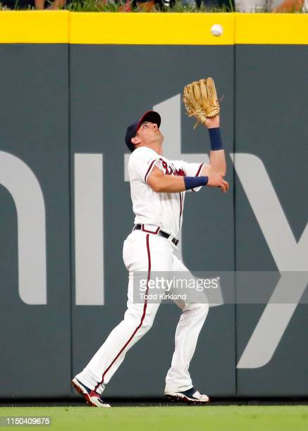 Austin Riley of the Atlanta Braves makes the catch in the outfield for an out in the seventh inning of an MLB game against the New York Mets at...
