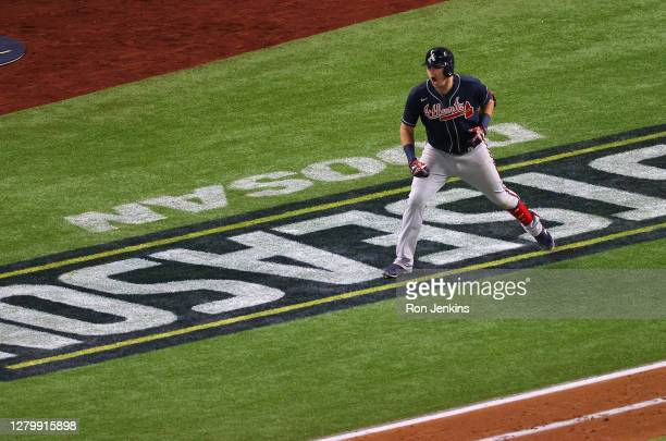 Austin Riley of the Atlanta Braves rounds the bases after hitting a solo home run against the Los Angeles Dodgers during the ninth inning in Game One...