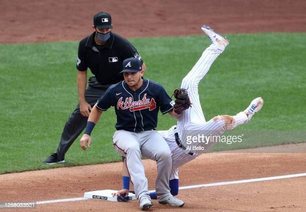 Austin Riley of the Atlanta Braves tags out Jeff McNeil of the New York Mets on a fielders choice hit by Pete Alonso of the New York Mets in the...