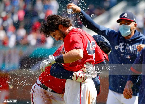 Austin Riley reacts with Dansby Swanson of the Atlanta Braves after Swanson's game winning single in the ninth inning of an MLB game against the...