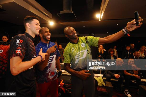 Austin Rivers and Chris Paul of the LA Clippers pose for a photo with Former NFL player Terrell Owens during the State Farm CP3 PBA Celebrity...