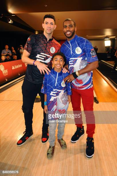 Austin Rivers and Chris Paul of the LA Clippers pose for a photo with Actor Miles Brown at the State Farm CP3 PBA Celebrity Invitational hosted by...