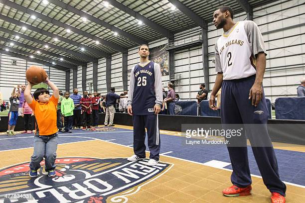 Austin Rivers and Darius Miller of the New Orleans Pelicans join teammates as they host a season ticket holders event on March 8 2014 at the New...