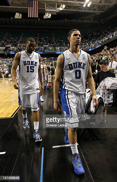 Austin Rivers and Josh Hairston of the Duke Blue Devils walk off the court after losing to the Lehigh Mountain Hawks 7570 during the second round of...