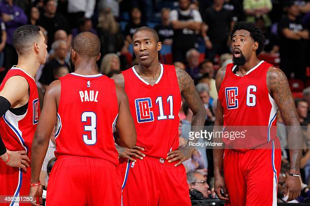 Austin Rivers Chris Paul Jamal Crawford and DeAndre Jordan of the Los Angeles Clippers face off against the Sacramento Kings on October 28 2015 at...