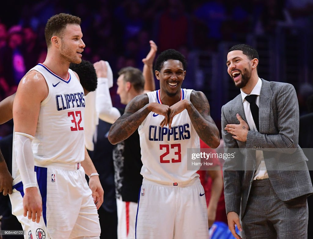 Austin Rivers #25, Lou Williams #23 and Blake Griffin #32 of the LA Clippers laugh during a stop in play in a 113-102 Clipper win over the Houston Rockets at Staples Center on January 15, 2018 in Los Angeles, California.