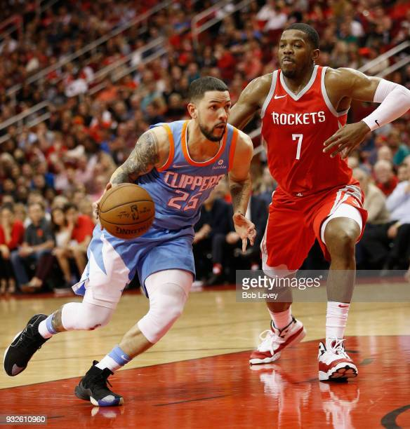 Austin Rivers of the LA Clippers drives aroundJoe Johnson of the Houston Rockets at Toyota Center on March 15 2018 in Houston Texas NOTE TO USER User...