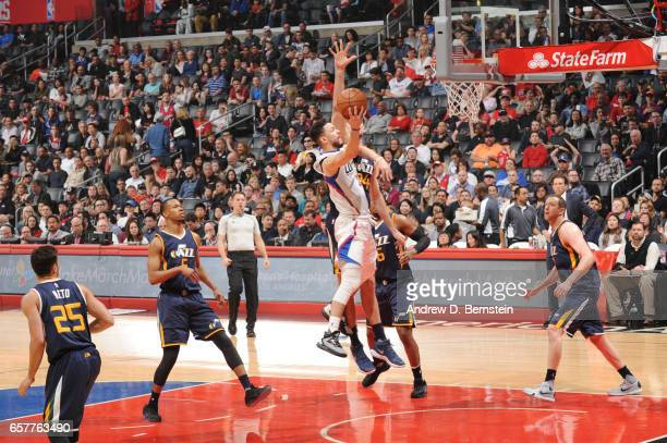 Austin Rivers of the LA Clippers goes up for a shot during a game against the Utah Jazz on March 25 2017 at STAPLES Center in Los Angeles California...