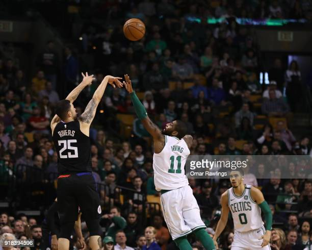 Austin Rivers of the LA Clippers shoots over Kyrie Irving of the Boston Celtics during the third quarter of the game at TD Garden on February 14 2018...