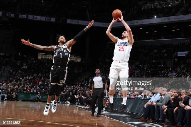 Austin Rivers of the LA Clippers shoots the ball against D'Angelo Russell of the Brooklyn Nets on February 12 2018 at Barclays Center in Brooklyn New...