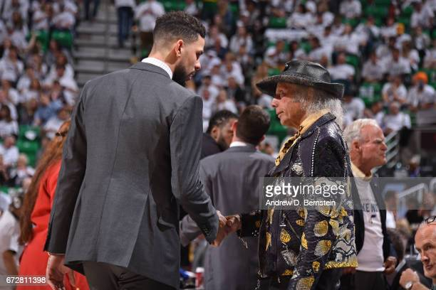 Austin Rivers of the LA Clippers talks to NBA superfan James Goldstein during Game Three of the Western Conference Quarterfinals against the Utah...