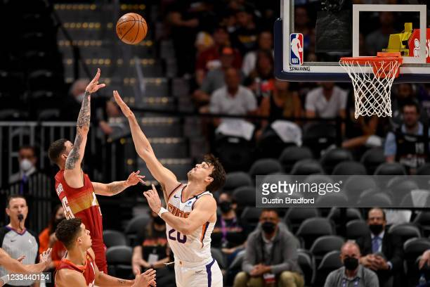 Austin Rivers of the Denver Nuggets shoots over Dario Saric of the Phoenix Suns in Game Four of the Western Conference second-round playoff series at...
