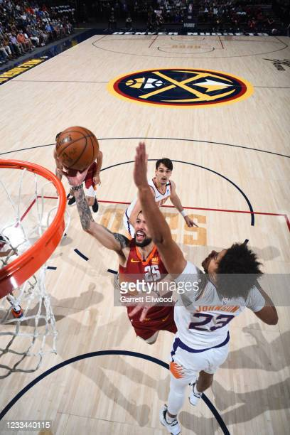 Austin Rivers of the Denver Nuggets shoots the ball during the game against the Phoenix Suns during Round 2, Game 4 of the 2021 NBA Playoffs on June...