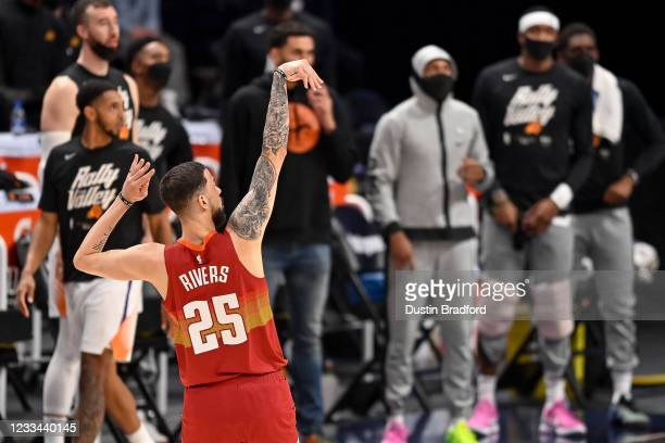 Austin Rivers of the Denver Nuggets watches a shot drop for two points in Game Four of the Western Conference second-round playoff series at Ball...