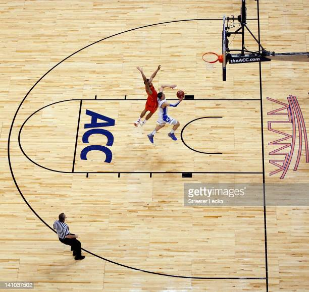 Austin Rivers of the Duke Blue Devils drives to the basket against Jarell Eddie of the Virginia Tech Hokies in their Quarterfinal game of the 2012...