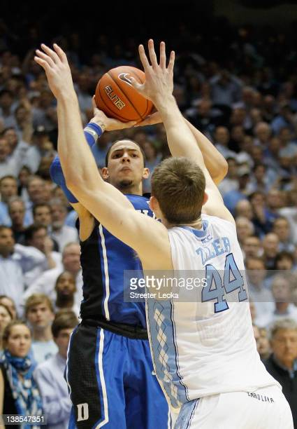 Austin Rivers of the Duke Blue Devils shoots the gamewinning 3 pointer over Tyler Zeller to defeat the North Carolina Tar Heels 8584 during their...