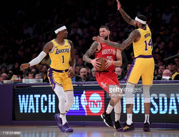 Austin Rivers of the Houston Rockets gets trapped by Brandon Ingram and Kentavious CaldwellPope of the Los Angeles Lakers during a 111106 Laker win...