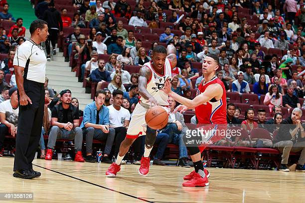 Austin Rivers of the Los Angeles Clippers defends against Delon Wright of the Toronto Raptors during their NBA preseason game on October 4 2015 at...
