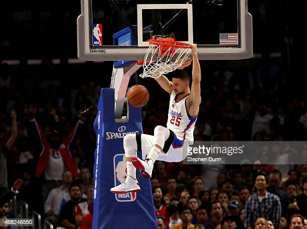 Austin Rivers of the Los Angeles Clippers dunks against the Golden State Warriors at Staples Center on March 31 2015 in Los Angeles California NOTE...