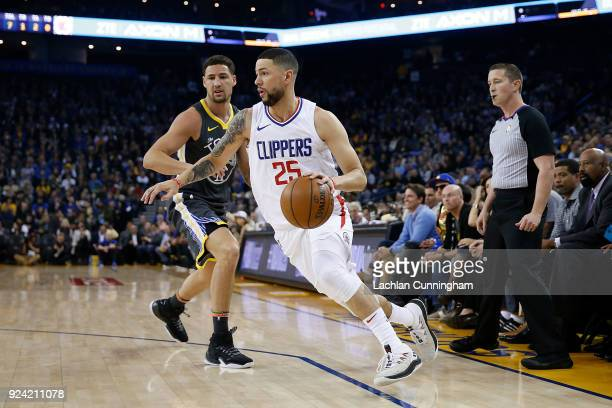 Austin Rivers of the Los Angeles Clippers gets by Klay Thompson of the Golden State Warriors as he drives to the basket at ORACLE Arena on February...