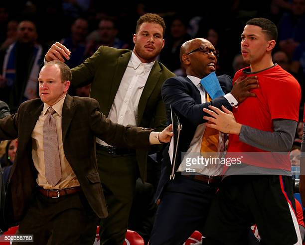Austin Rivers of the Los Angeles Clippers is held back by Sam Cassell and Blake Griffin as players from the New York Knicks and the Los Angeles...