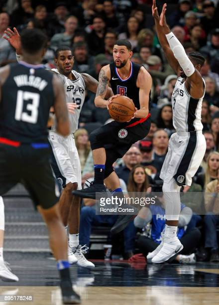 Austin Rivers of the Los Angeles Clippers looks to pass to teammate Jamil Wilson of the Los Angeles Clippers in front of LaMarcus Aldridge of the San...