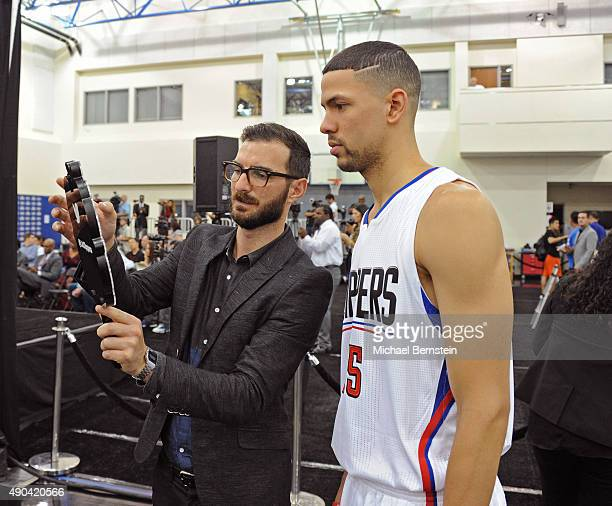 Austin Rivers of the Los Angeles Clippers poses for a photo with the Twitter Mirror during media day at the Los Angeles Clippers Training Center on...