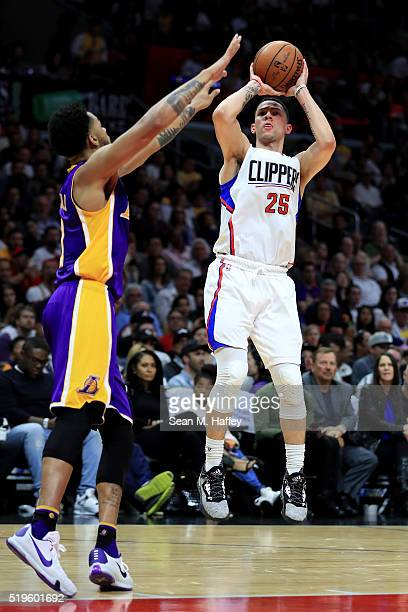 Austin Rivers of the Los Angeles Clippers shoots from outside over D'Angelo Russell of the Los Angeles Lakers during an NBA game between Los Angeles...