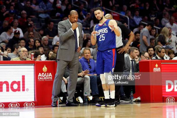 Austin Rivers of the Los Angeles Clippers speaks to Doc Rivers of the Los Angeles Clippers during the game at Staples Center on April 7 2018 in Los...