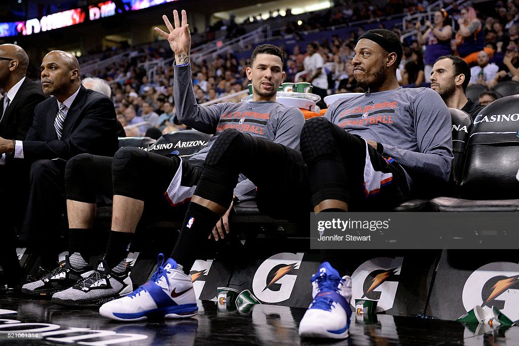 Austin Rivers #25 of the Los Angeles Clippers (L) talks with teammate Paul Pierce #34 while sitting on the bench during the NBA game against the Phoenix Suns at Talking Stick Resort Arena on April 13, 2016 in Phoenix, Arizona. The Suns defeated the Clippers 114 - 105.