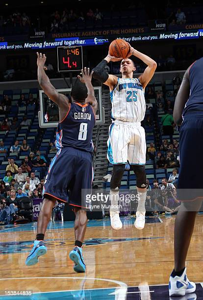 Austin Rivers of the New Orleans Hornets goes for a jump shot against Ben Gordon of the Charlotte Bobcats during the game between the New Orleans...