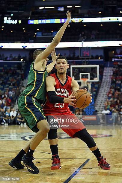 Austin Rivers of the New Orleans Pelicans works against Dante Exum of the Utah Jazz during the second half of a game at the Smoothie King Center on...