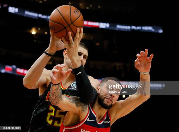 Austin Rivers of the Washington Wizards attempts a steal on a rebound by Alex Len of the Atlanta Hawks at State Farm Arena on December 5 2018 in...
