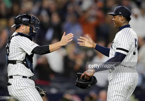 Austin Romine and Aroldis Chapman of the New York Yankees celebrate the 91 win over the Los Angeles Angels to clinch of the American League East...
