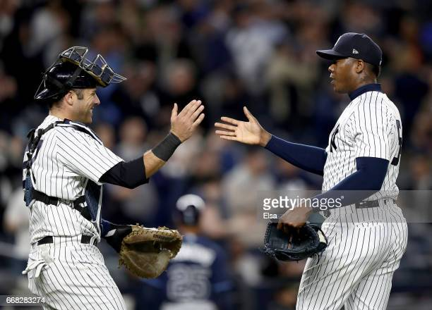 Austin Romine and Aroldis Chapman of the New York Yankees celebrate the 3-2 win over the Tampa Bay Rays on April 13, 2017 at Yankee Stadium in the...