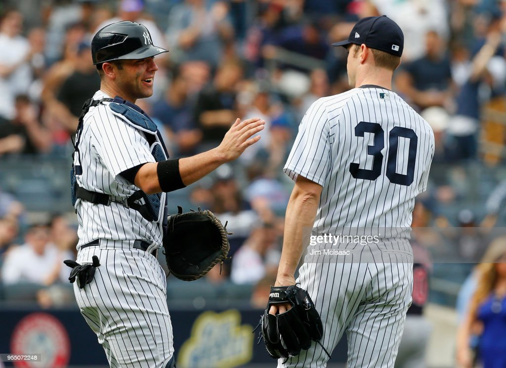 Austin Romine #28 and David Robertson #30 of the New York Yankees celebrate after defeating the Cleveland Indians at Yankee Stadium on May 5, 2018 in the Bronx borough of New York City.