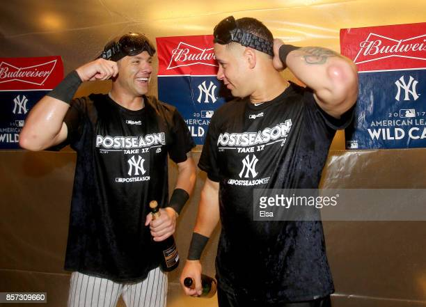 Austin Romine and Gary Sanchez celebrate the win over the Minnesota Twins of the New York Yankees during the American League Wild Card Game at Yankee...