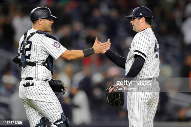 Austin Romine and Joe Harvey of the New York Yankees celebrate after the Yankees defeated the Boston Red Sox at Yankee Stadium on Tuesday April 16...