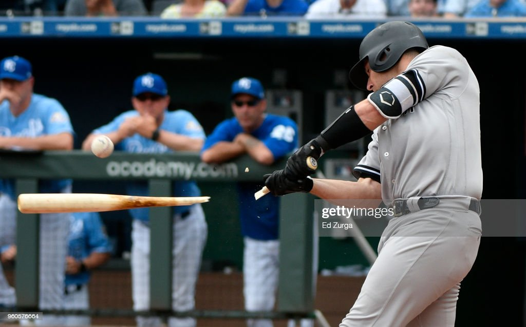 Austin Romine #28 of the New York Yankees breaks his bat as he hits a RBI single in the fourth inning against the Kansas City Royals at Kauffman Stadium on May 20, 2018 in Kansas City, Missouri.