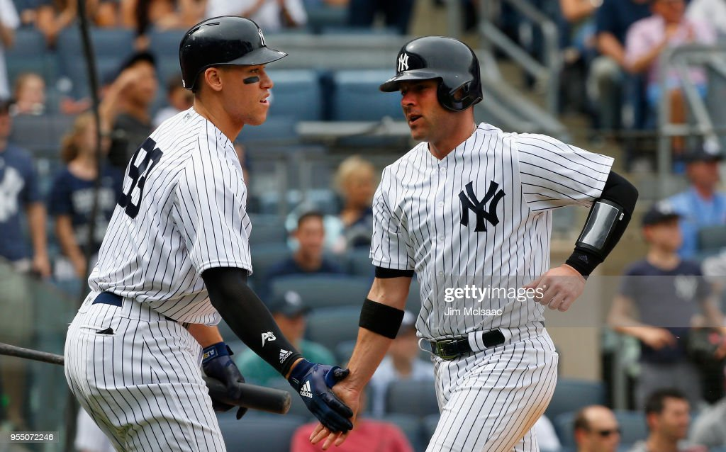 Austin Romine #28 of the New York Yankees celebrates with teammate Aaron Judge #99 after scoring in the seventh inning against the Cleveland Indians at Yankee Stadium on May 5, 2018 in the Bronx borough of New York City.