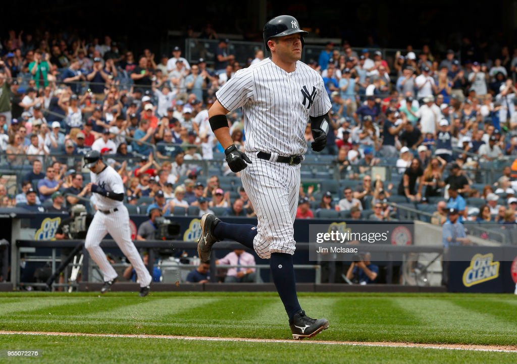 Austin Romine #28 of the New York Yankees draws a bases loaded walk in the fifth inning against the Cleveland Indians scoring teammate Neil Walker #14 at Yankee Stadium on May 5, 2018 in the Bronx borough of New York City.
