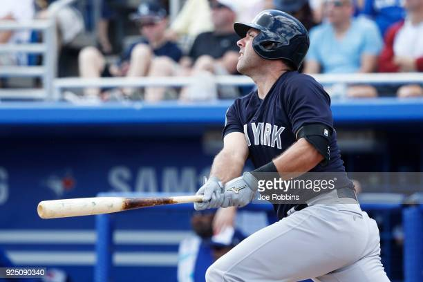 Austin Romine of the New York Yankees hits a double to lead off the second inning of a Grapefruit League spring training game against the Toronto...